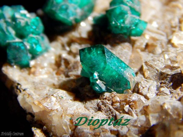 Dioptase crystals on calcite - Altyn Tjube, Kazakhstan